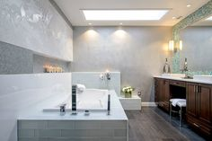 A sleek #master #bath is a #contemporary oasis, with transparent glass patterned screens, sculpted walls and a minimalist glass-tiled tub.  #INTERIOR #DESIGN: De Space Designs | See more projects at: http://www.HandD.com/DianeTaitt