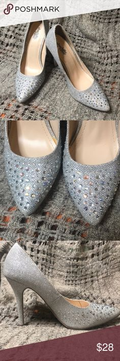 Sliver Sparkle Heels with gems size 7 Charlotte Russe size 7 style: momentum. These shoes are lightly worn. The are sliver sparkles with clear and iridescent gems. Great addition to any closet! Charlotte Russe Shoes Heels
