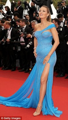 Snug around her form, the number - which also featured a thigh-high slit - gave onlookers ...