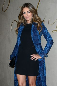 Elizabeth Hurley Photos - Elizabeth Hurley arrives for the premiere of the Burberry festive film at Burberry on November 2015 in London, England. - The Premiere of the Burberry Festive Film - Arrivals Elizabeth Hurley, Hollywood, I Dress, Her Hair, Color Combinations, Looks Great, Burberry, Hot Pink, Cover Up