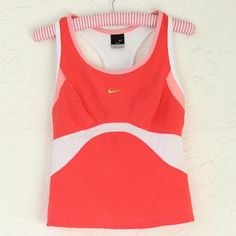 """Nike Dri-Fit Built in Bra Coral Top (M) ❤️ BUNDLES  ❤️ Discounts on Budles  ❌ NO TRADES  ❌ NO Low Balling!!  • Pre-Owned •  •Excellent Condition•   -With Built in Global Bra / Side and Back Ventilation  -Fabric content:  -Fabric: 84% Polyester / 16% spandex  Color:  Pinks/ White/ Yellow Nike Swoosh  Size: Medium  Length: 20"""" Approximately  Width from under arm to under arm: 15 1/2"""" Approximately Nike Tops Tank Tops"""