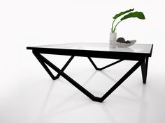 interior design Spider 3 legged table by MADA