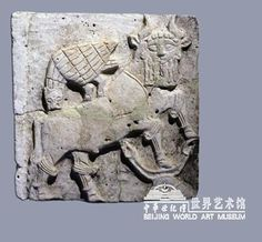 Bas relief of Anzud attacking a man-headed bull. For more information on Imdugud/Anzud, see Beijing World Art Museum for an article by Richar Zettler