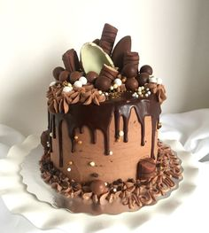 Drip Cake for the Chocolate Lover. Tutorial on how to make this intense chocolate drip cake with Twix, maltesers or whoppers, chocolate frosting, and chocolate cake.