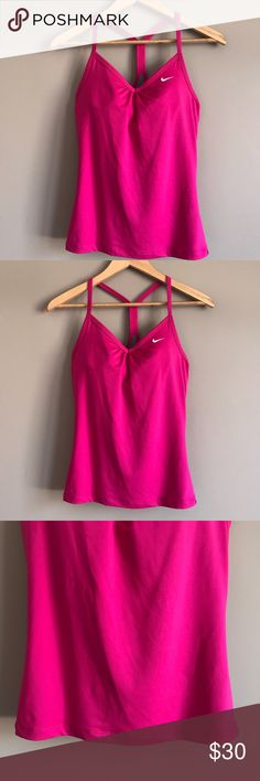 Nike Dri-Fit Athletic Racerback Tank Awesome hot pink color and built-in bra. Used but still in perfect condition. Nike Tops