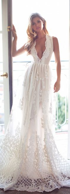 The gorgeous lace detailing of this Lurelly bridal wedding dress is perfect for the destination beach bride!