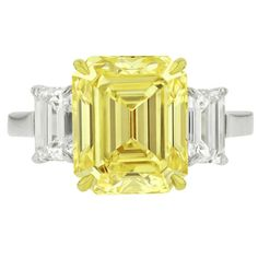 Rare 5.59 Carats Fancy Yellow VS2 Emerald cut Diamond Ring | From a unique collection of vintage bridal rings at https://www.1stdibs.com/jewelry/rings/bridal-rings/
