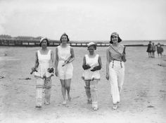 12th May 1934: A group of women dressed for a game of cricket on the beach. (Photo by Reg Speller/Fox Photos/Getty Images) Real Cricket on the Beach....its no tennis balls and bikinis!