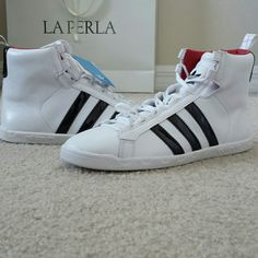 NWT Adidas Originals mid sneakers BRAND NEW WITH TAGS Adidas Originals mid hight sneakers SOLD OUT Women's mid top sneaker  Black adidas stripes on side of shoe  Lace closure  Padded tongue with adidas logo  Cushioned sole for ultimate comfort FIT: True to size FABRIC: Leather Adidas Shoes Sneakers