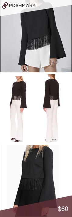 """Vertigo"" Black Fringe Crop Top A playful curtain of fringe trims the cropped hem of this playful top styled with '70s-inspired bell sleeves. 17"" length; 4"" fringe (size Medium). Hidden back-zip closure. Bateau neck. Long bell sleeves. 100% polyester. Finders Keepers Tops"