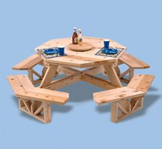 "Octagon Picnic Table Woodworking Plan Make this attractive octagon table to fully enjoy your outdoor family dining experience. This table has easy ""walk-in"" seating for up to eight and accepts a standard umbrella for those hot summer days. #diy #woodcraftpatterns"