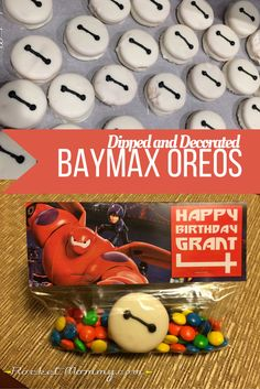 Dipped and decorated Baymax Oreos - perfect for any Big Hero 6 fan! Serve as part of a dessert display for parties or package them up as favors.  From www.rocketmommy.com | Rocket Mommy | A launching pad for creative ideas