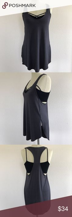 Express Tank Express One Eleven racer back tank. Charcoal gray color with side slits. Very soft material, perfect to wear with leggings for workout, yoga or just being comfy! Even looks cute layered with a bralette and jeans. I have it shown styled with a black strappy bralette, not included. Size small and in great condition   ✖️No Trades ✖️No Holds ✖️No Modeling ✖️No PayPal / Merc Express Tops Tank Tops
