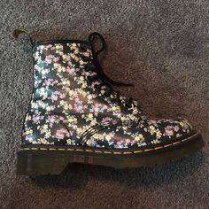 Dr. Martens Floral Boots These black and floral 8 eyed boots will never go out of style. Wether you like 90s grunge or just love the new hip styles, you can wear them with almost anything. I've worn them only a few times so, they're practically brand new. (I had to buy a larger pair) Dr. Martens Shoes
