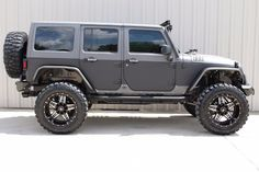 2015 GRAY & BLACK KEVLAR COATED JEEP WRANGLER UNLIMITED SPORT WITH 5.25″ LIFT AND 37″ TIRES – $74,995   American Wheel and Tire