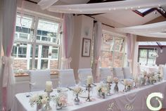 Top table flowers and candles with window decorations