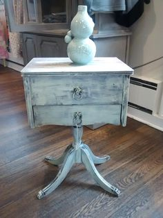 Antique sewing table that I love for a small side table with storage.  Painted in American Paint Co. Spacious Skies and Liberty, distressed and waxed.