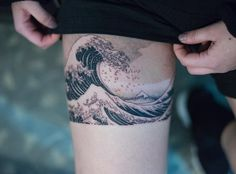 Hokusai wave tattoo on thigh by Oozy