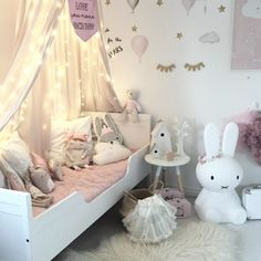 Cute, whimsical girl's room full of softness and shades of pink.