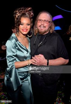 Singer Andra Day and honoree Barry Gibb of the Bee Gees attend 'Stayin' Alive: A GRAMMY Salute To The Music Of The Bee Gees' on February 14, 2017 in Los Angeles, California.