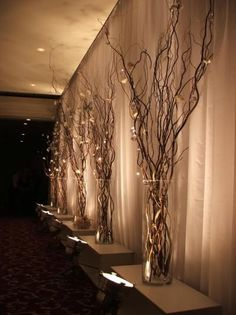 Willow Branch Decor: Image via Pinterest. Rental includes hurricane glass vase and willow branches - Lighting not included.