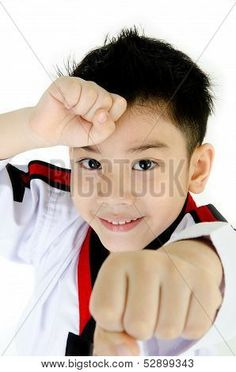 Picture or Photo of Taekwondo action by a asian cute boy isolate on white background