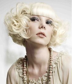 platinum blonde curly short bob with blunt bangs