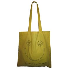 - Ultra thin, soft and slouchy, boho tote with smiley face design printed on both sides of the yellow bag  - Smiley face has opposing pentacle and inverted pentacle eyes  - 14 ½ inches x 14 ½ inches  - Oversized handles have a 13 inch drop  - FREE GIFT with purchase