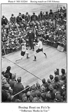 Boxing match on the U.S.S. Siboney's forecastle, while she was at sea in the Atlantic Ocean, transporting troops to or from France in 1918-1919. Spectators are wearing masks as a precaution against the spread of influenza.