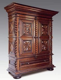 Typical Louis XIII Style Armoire with the Diamond Point carving and the bun feet. C.1640