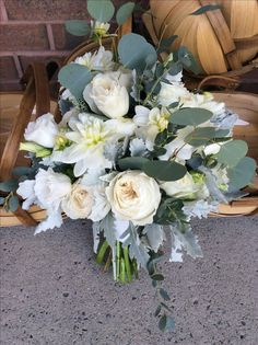 More greenery in wedding bouquets is a wonderful trend.