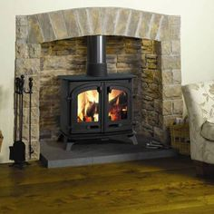 wood stoves-- would love this with a nice mantle above it to decorate!