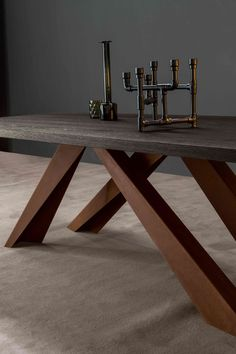 Big Table with the top brushed anthracite grey polished oak and legs in corten By Bonaldo #bonaldo #table #bigtable #oak #polished #grey #anthracitegrey #corten #new #interior #design #interiordesign #modern #wood #home #ollection #sculptural