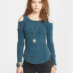Free people ballerina top Beautiful cutout shoulders add cool vintage appeal.  Super cute cold shoulder top.  This item is very popular and hard to find. Color: deep sea blue Free People Tops