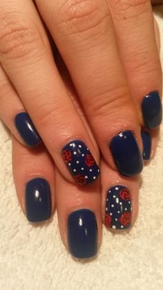 Red Roses in blue nail design