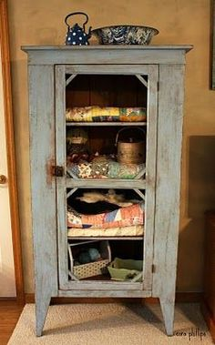 Old Handmade Primitive Pie Safe...now redone with stacks of old quilts on the shelves.  By Heartfelt and Homemade. #Primitivefurniture