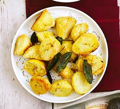 Roast potatoes don't need to be unhealthy. Use a little rapeseed oil and flavour with citrus and herbs