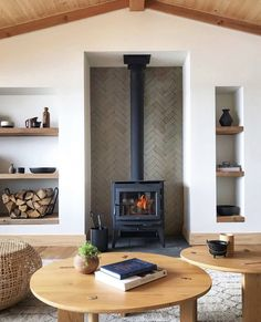 this scandinavian inspired cabin exemplifies natural home design, making our rustic thin brick tile the perfect pick for this fireplace surround. shown: clé foundry flats thin brick subway tile in sand cast. Home Fireplace, Brick Fireplace, Fireplace Surrounds, Fireplace Design, Herringbone Fireplace, Small Fireplace, Basement Fireplace, Cottage Fireplace, Modern Fireplaces