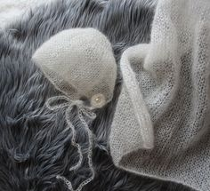 Ravelry: Mohair Lace Bonnet & Mini Blanket with Crochet Rosette pattern by Angie Hartley