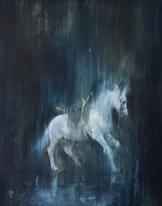 White Horse in Motion 1 By Jake Wood-Evans The white horses' colors are blended with the background to show the quick motion.