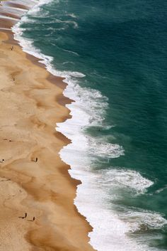 the way the waves kiss the shore