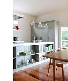 kitchen – beautiful muted tones in the cabinetry, also love the wishbone dining chairs – super perfect in this space.