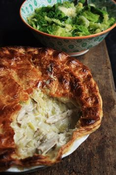 What is November without a good pie? Cold, that's what. Is there really any better internal heating system that a plate full of hot bubbling creamy chicken and sweet leeks adorned with a crisp and . Creamy Chicken Pie, Chicken And Leek Pie, Good Pie, Man Food, Lunch, Dinner, Savoury Pies, Cooking, Ethnic Recipes
