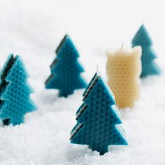 to make 10 identical shapes from the wax sheets. Divide the shapes into two stacks of 5.  Sandwich a wick between the two stacks, starting a...