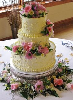 Pink, lavender, 3-tier round wedding cake with fresh spring color flowers. Scrollwork on sides | Yelp