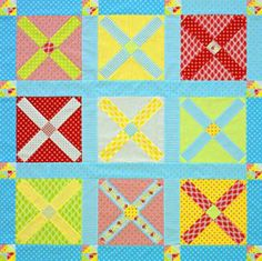 Arrange blocks of bright, springtime fabrics to create a nine-block throw with a game-board vibe.