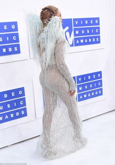 Sheer daring: Beyonce's see-through skirt showed off her derriere and legs