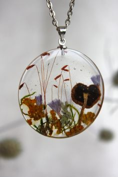 Transparent pendant with mushroom, blue flowers and moss. Round Pendant . Pendant epoxy resin. Dry plants pendant by Dingaya on Etsy