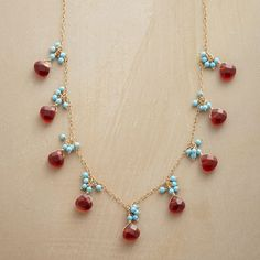 "SKY DROPLETS NECKLACE -- Drops of turquoise and carnelian, enhanced to convey the brilliant colors of sun and sky. Handcrafted in 14kt gold filled exclusively for us. Lobster clasp. 16"" to 18""L."