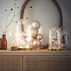 Guirlande lumineuse sous cloche pour une décoration de noël féérique et moderne